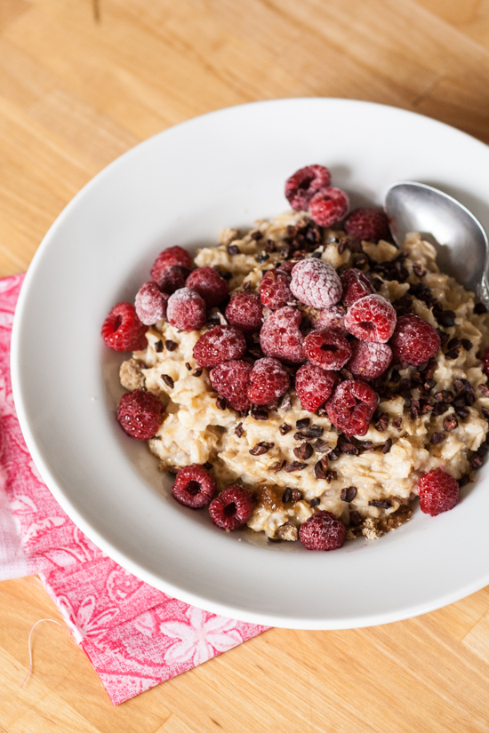 A hearty breakfast of oatmeal with raspberries and cocoa nibs will get your day off to the right start.