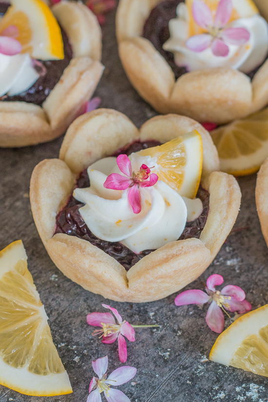 These adorable mini cherry pies are simple to serve and delicious to eat. Top with Meyer lemon cream for a burst of citrus flavor. A great recipe for parties!