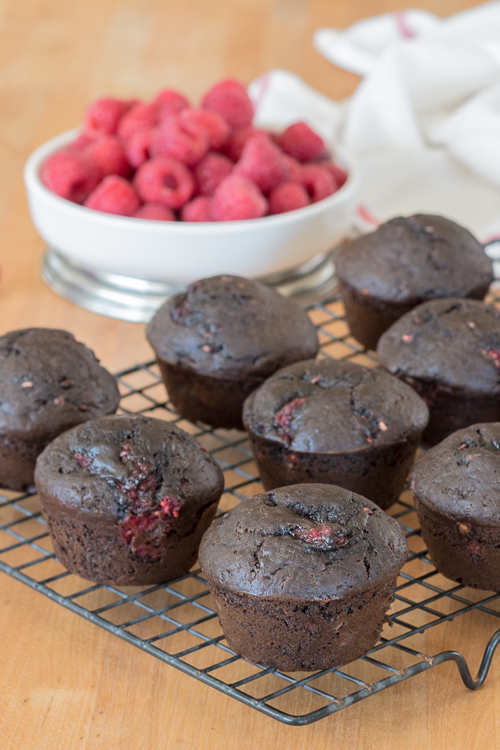 Cocoa powder imparts bittersweet chocolate flavor and juicy raspberries add tart sweetness to these Chocolate Raspberry Muffins. This quick, easy snack recipe is a serious crowd pleaser.