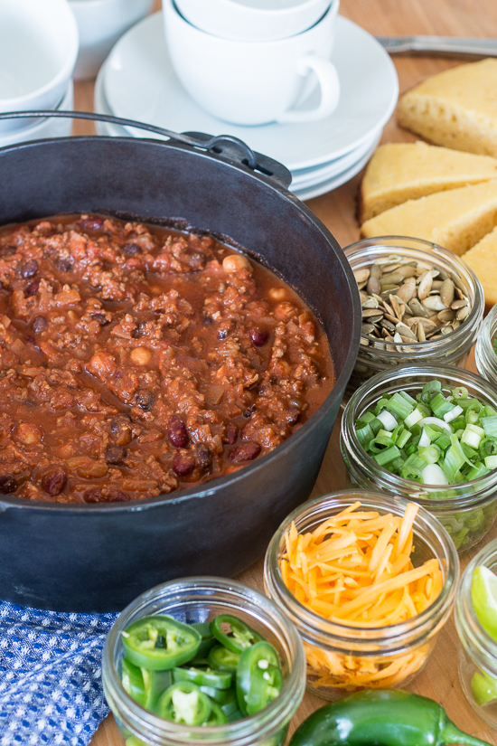 Bacon adds richness and smoked paprika imparts a deep, complex flavor to this easy Beef and Bean Chili. Serve it on its own or with rice, baked potatoes, or mac and cheese! This recipe produces a generous pot of chili, which makes it great for parties and leftovers.