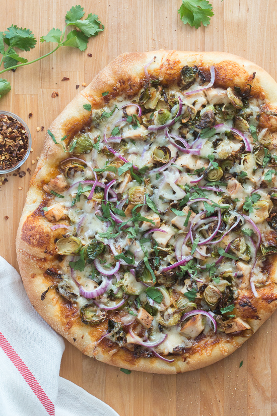 Sweet, tangy barbecue sauce provides a flavorful, fun twist to homemade pizza. Topped with cooked chicken, roasted Brussels sprouts, red onion and Gruyere cheese, this simple barbecue pizza tastes totally gourmet!
