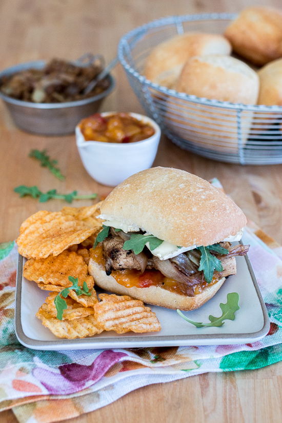 These Grilled Chicken and Brie Sandwiches with Mango Chutney and Balsamic Onions make a perfect meal or party dish! Ciabatta, with its chewy open texture, offers up plenty of nooks and crannies to capture the rich, creamy Brie,tangy mango chutney, and tender balsamic onions.