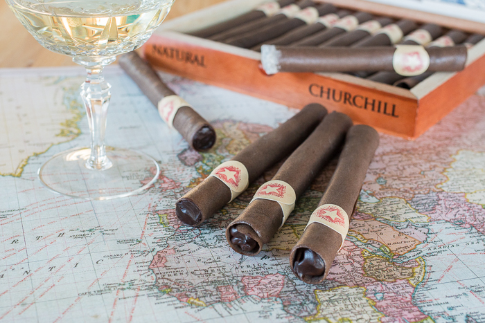 These Chocolate Tuile Cigars with Whisky Ganache feature wafer-thin chocolate cookies loaded with boozy chocolate. This truly decadent treat provides a sweet alternative to the idea of celebratory cigars!