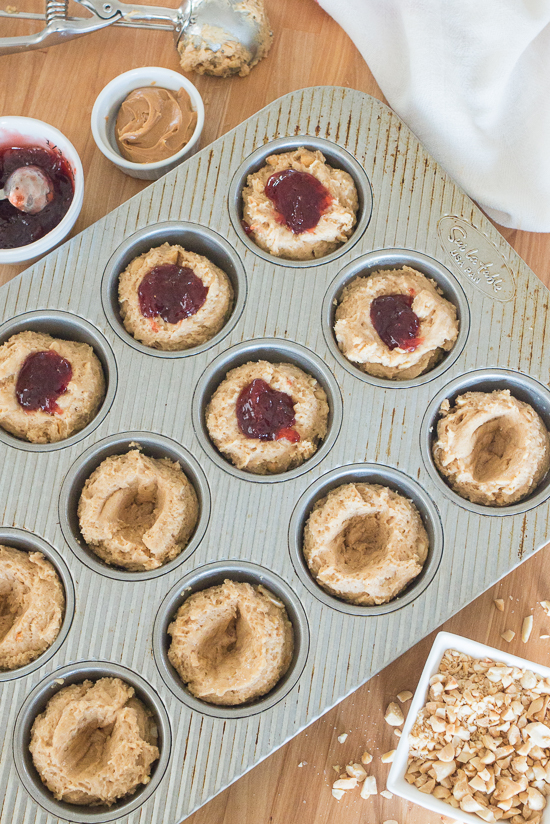 Nutty and fruity with great crunch from a generous quantity of chopped peanuts, these Peanut Butter and Jelly Muffins will surprise and delight family and friends.