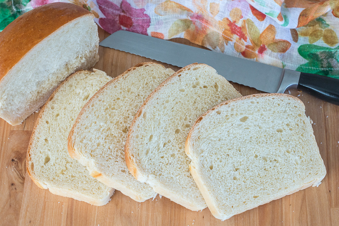 With a glossy golden crust and creamy white interior, this Classic Sandwich Bread is tender and silky yet sturdy enough for piling high with cold cuts, veggies, and spreads or grilling with your favorite cheese.