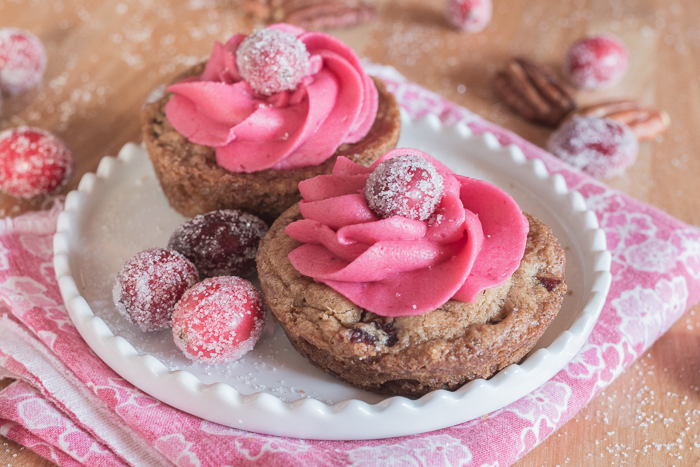 With their deep pink cranberry buttercream and glittery cranberries, these pretty Muffin Tin Cranberry-Pecan Blondies make a great, easy-to-serve dessert for festive occasions.