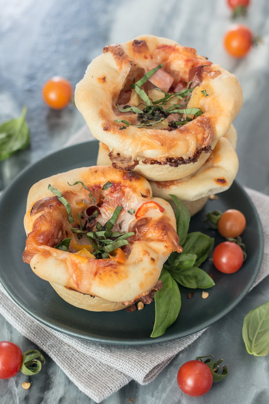 These Mini Deep Dish Pizzas deliver big flavor in adorable muffin-sized packaging. Loaded with mozzarella cheese, flavorful tomato sauce, and tasty fillings, these petite pizzas make a satisfying, easy-to-prepare meal.