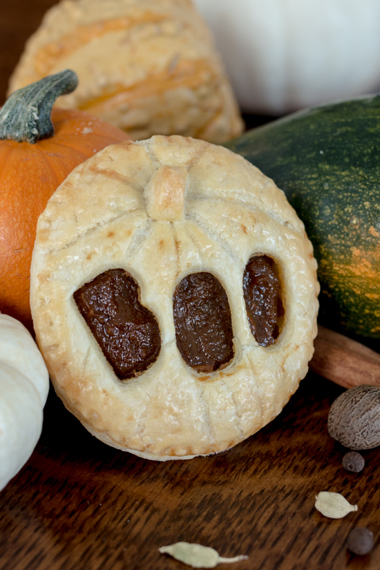 Perfect for Halloween, these adorable Jack-O'-Lantern Pumpkin Hand Pies feature a velvety-smooth pumpkin filling tucked between layers of rich, flaky pastry.