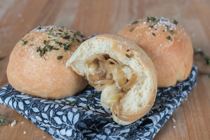 Imagine the amazing combination of flavors in French Onion Soup -- deep, rich, and sweet caramelized onions and nutty, smooth Gruyere cheese -- wrapped up in soft, tender bread, and you'll have these Caramelized Onion and Gruyere-Stuffed Rolls.