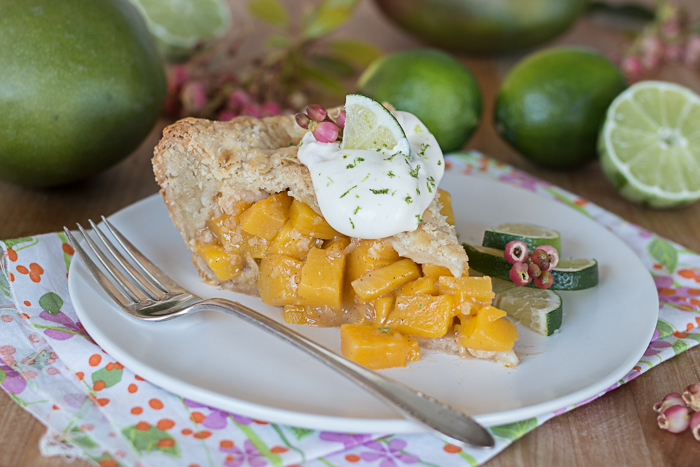 Mango Pie topped with Lime Whipped Cream delivers vibrant, tropical flavors in a delightfully flaky pastry packaging.