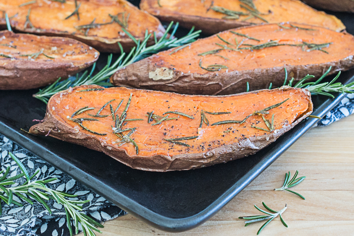 Quick and easy Rosemary Roasted Sweet Potatoes provide a vibrant, flavorful addition to any meal. Their bright orange color looks gorgeous on your plate!