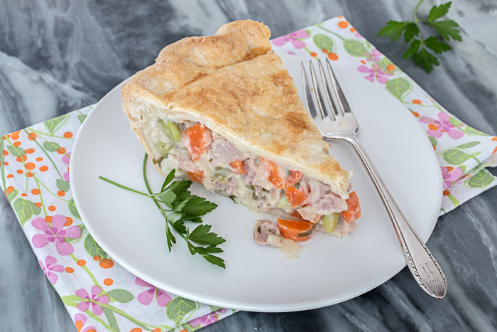 This Ham Pot Pie wraps up flavorful, smoky ham and plenty of vegetables in a flaky, buttery pastry to deliver comfort food at its best.