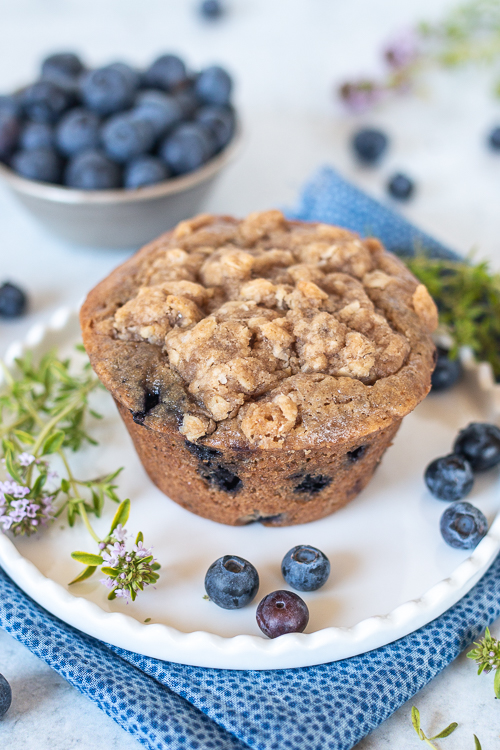 Sweet, tart blueberries add fruity flavor to these warm and satisfying Spiced Blueberry Muffins. A ginger-streusel topping adds texture and pizzazz!