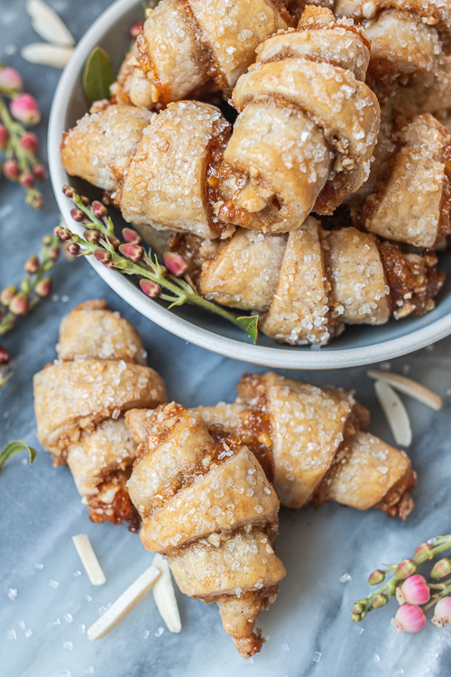 Tender, flaky cream cheese pastry provides the perfect vehicle for apricot jam and sweet almond filling in these Apricot-Almond Rugelach.