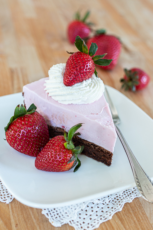 This simple, easy-to-prepare Strawberry Ice Cream Cake features a decadent, fudgy chocolate cake topped with sweet, fruity ice cream.